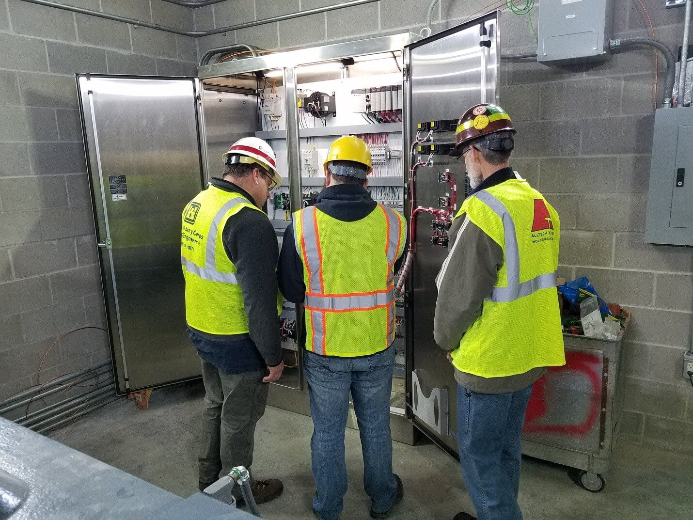 Three Men Looking at the Electrical at Upper St. Anthony Falls Lock and Dam