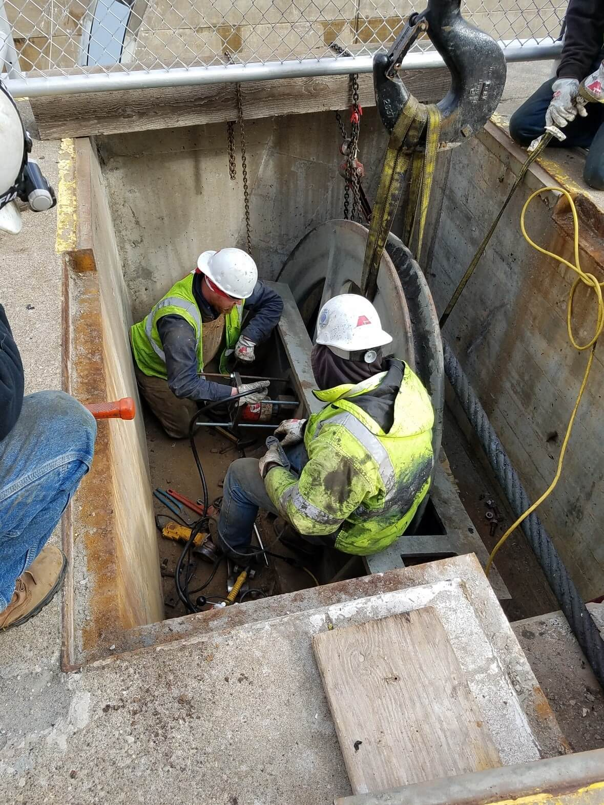 Two Men Working in a Small Space at Upper St. Anthony Falls Lock and Dam